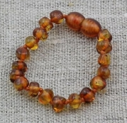 The Art of CureTM Baltic Amber Baby Teething Bracelet - Honey Amber W/the Art of Cure Jewelry Pouch-TM